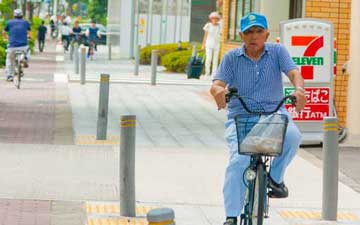 A man riding the bike in Osaka